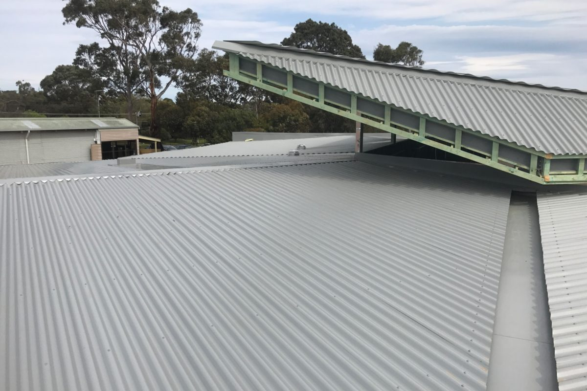 Buckland Roofing roof plumbers installing metal roof on school building