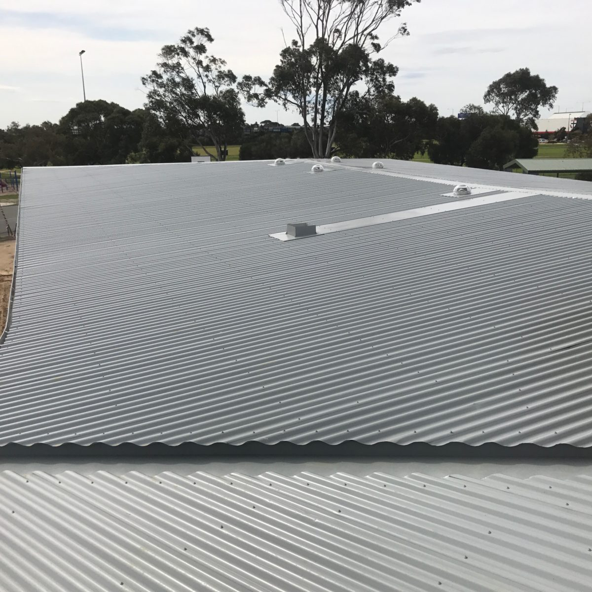 Buckland Roofing roof plumbers installing metal roof on school building