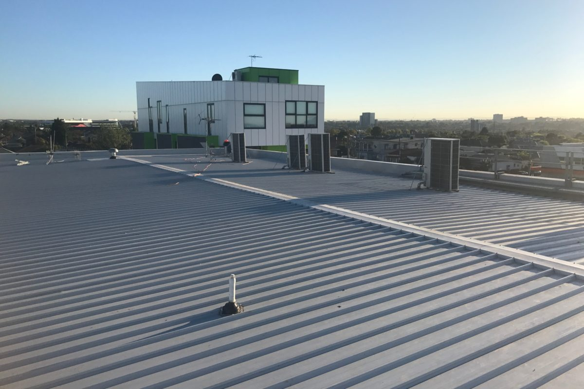 Buckland Roofing roof plumbers installing metal roof on commercial property