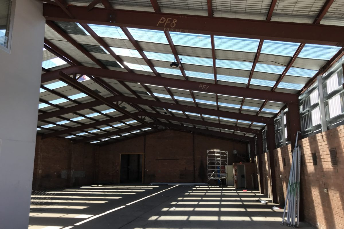 View of metal roof installed by Buckland Roofing from inside commercial property