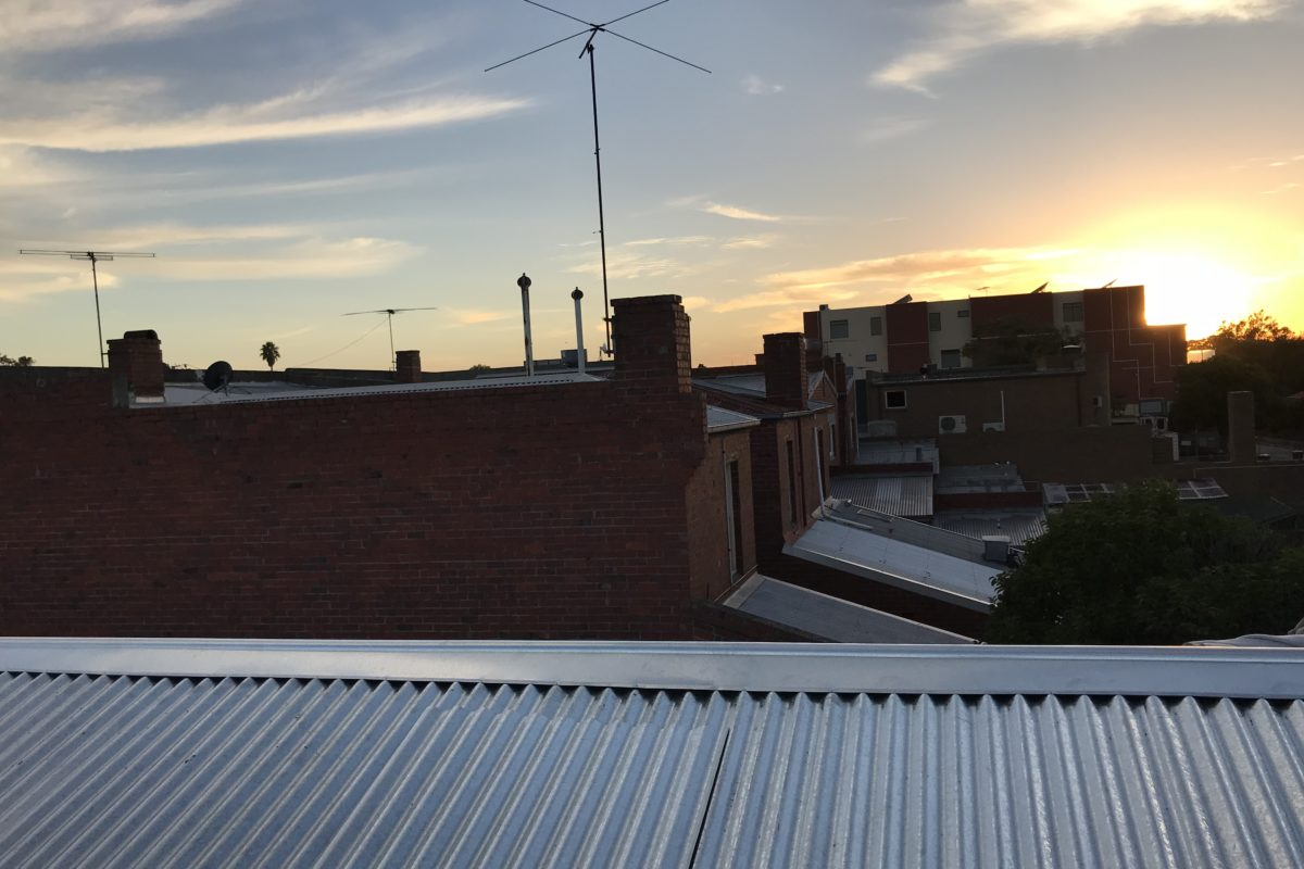 Sun setting over metal roof installed by Buckland Roofing