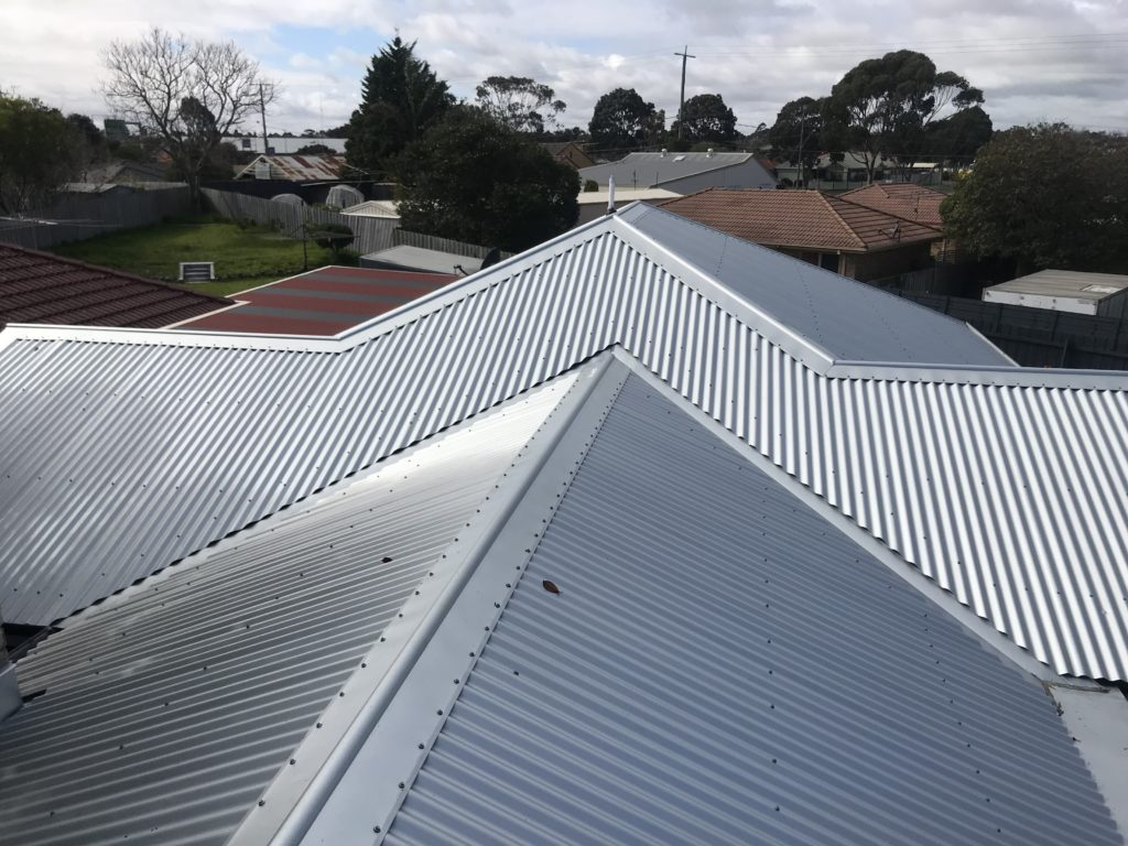 Buckland Roofing roof plumbers installing metal roof on home