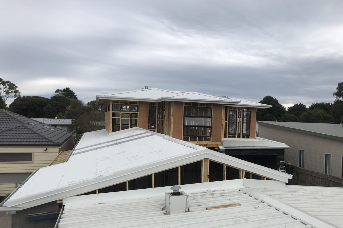 Buckland Roofing roof plumbers installing metal roof on residential property
