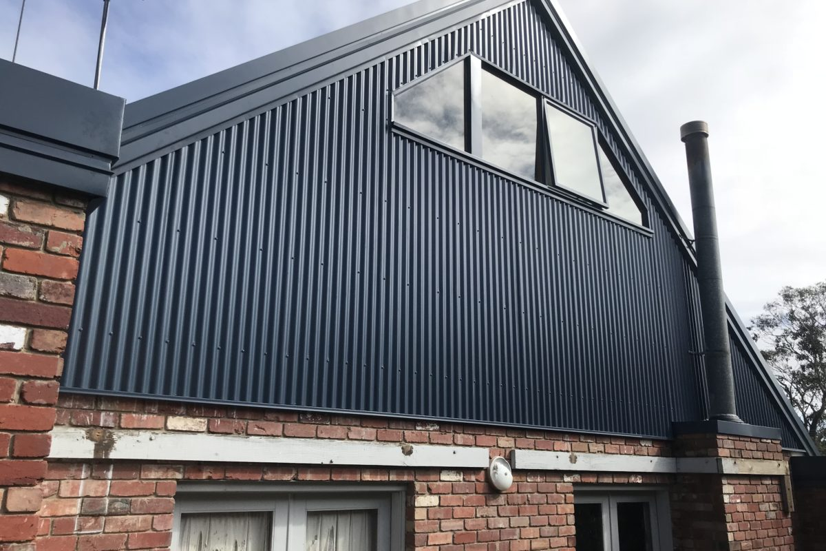 Buckland Roofing roof plumbers installing metal wall cladding on home